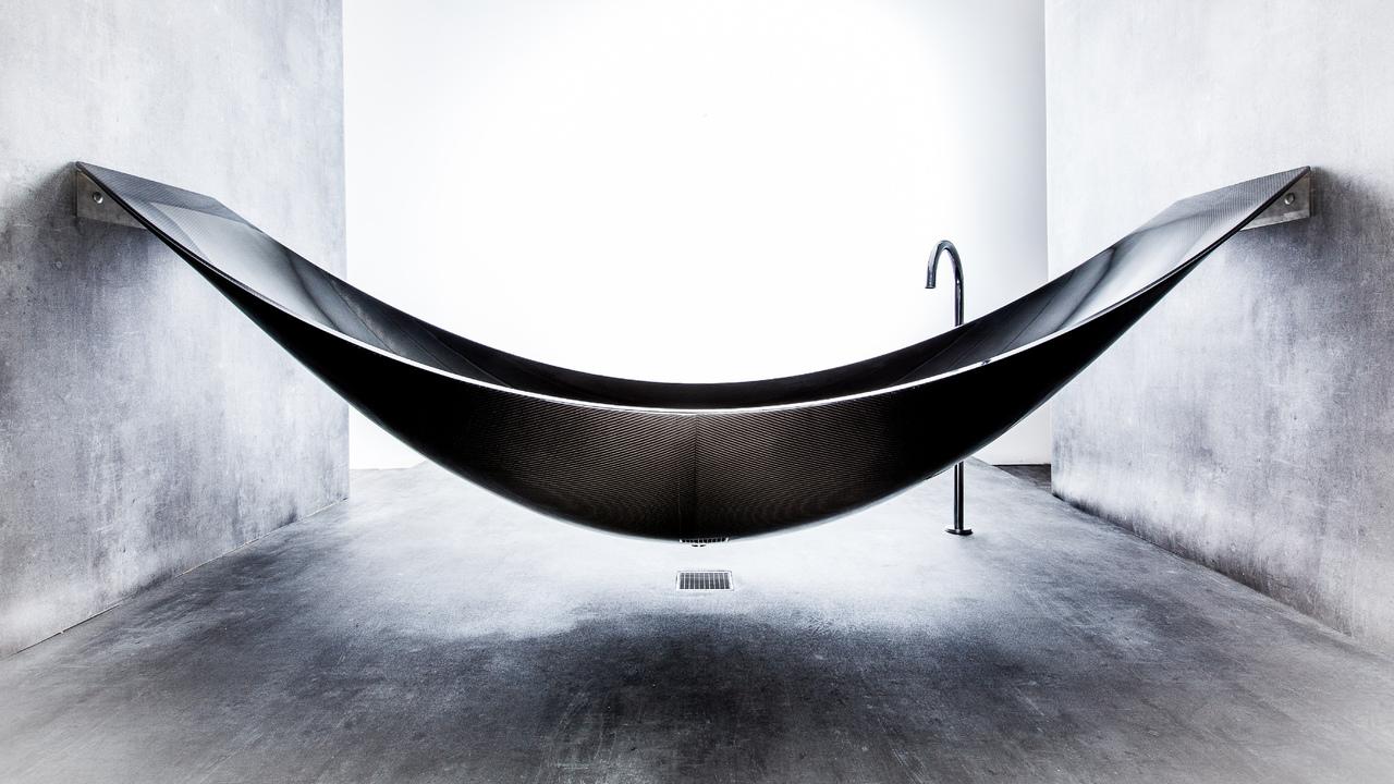 Desire this vessel a hammock style bathtub by splinter for Splinter works hammock bathtub