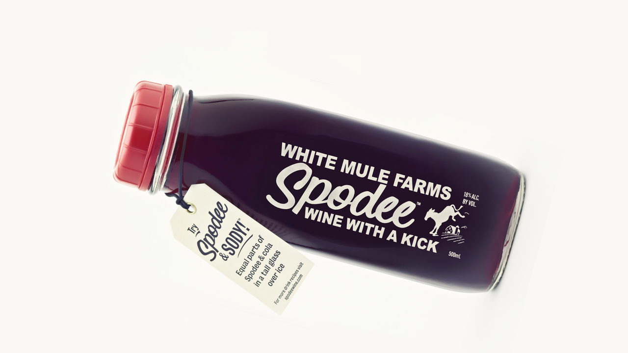 Spodee Homemade Country Wine in a Milk Bottle